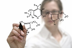 An image of a researcher drawing a chemical compound